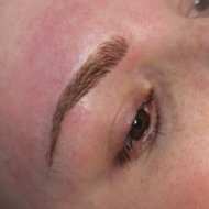 Cosmetic tattoo eyebrows after hairstroke treatment
